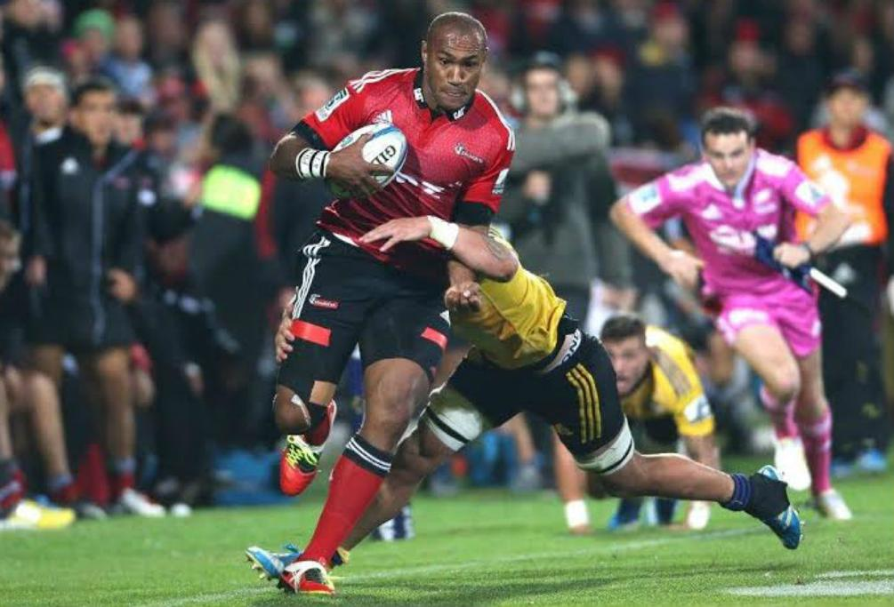Nemani Nadolo makes a charge down the wing for the Crusaders against the Hurricanes.