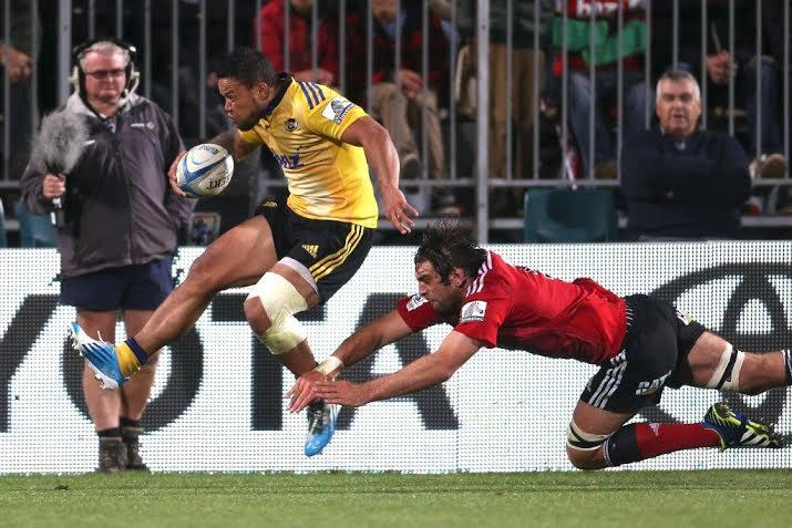 Alapati Leiua goes over to score the match-winning try for the Hurricanes against the Crusaders.