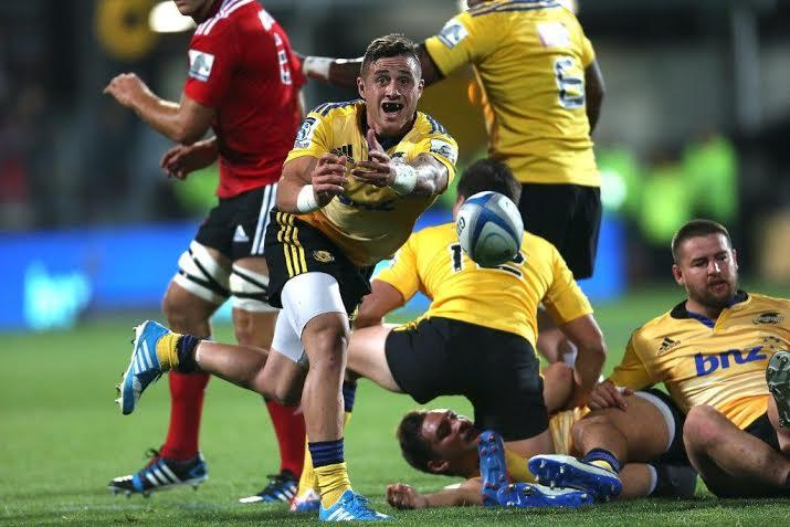 Hurricanes halfback TJ Perenara spins a lovely pass from a ruck against the Crusaders.