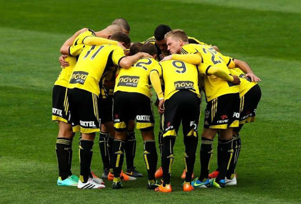 Wellington Phoenix players huddle together before their clash with Adelaide United at Westpac Stadium.