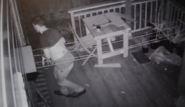CAUGHT IN THE ACT: The dawn intruder is caught on CCTV footage making off with a bra from the washing line.