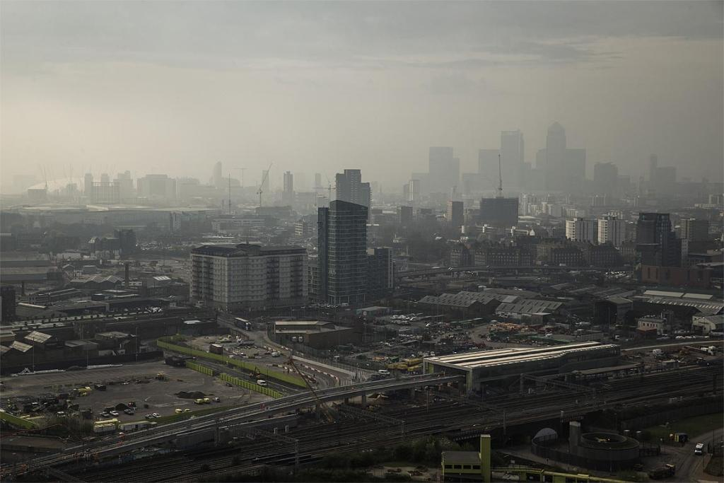Smog covers Canary Wharf and the O2 arena in London.