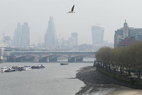 A haze sits over the skyline of London as Sahara dust and European emissions combine to create record smog.