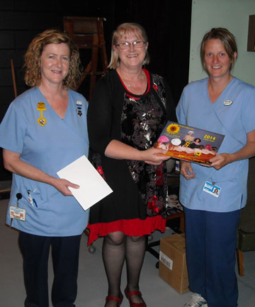 Incoming president and director of Calendar Girls Ngaire Taylor presents the cheque to representatives of the Clutha Health First Palliative Care Fund, Rhonda Munro, left, and Carolyn Upston, right.