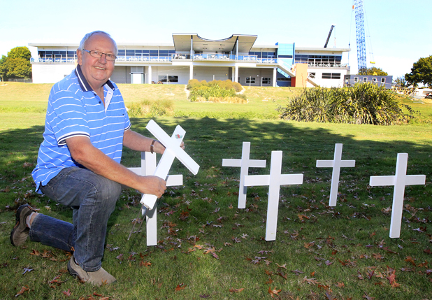 His part: Rapaura Timber owner Graham Sutton with some of the crosses that will be planted along the Taylor River to honour fallen Marlborough soldiers. His business supplied much of the wood used to make the 250 crosses being planted