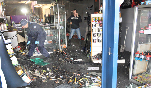 MOLOTOV MESS: Fire services southern region fire safety officer Stuart Ide and Constable Graeme King investigate the fire at Impuls'd in Invercargill.
