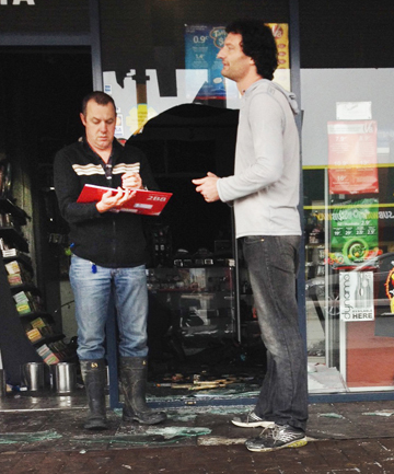 'THIS WON'T STOP ME': Constable Graeme King talks to Impuls'd owner Warren Skill after the firebombing.
