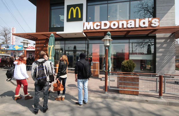 NO HAPPY MEAL: People gather outside a McDonald's restaurant, which was earlier closed for clients, in the Crimean city of Simferopol.