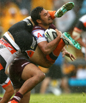Peta Hiku of the Sea Eagles is tackled by Luke Brooks of the Tigers.