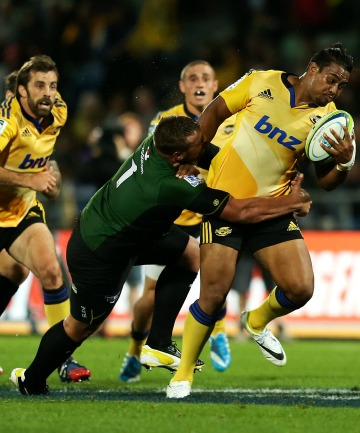 Julian Savea tests the Bulls' defensive line yet again, with senior men Jeremy Thrush and Conrad Smith