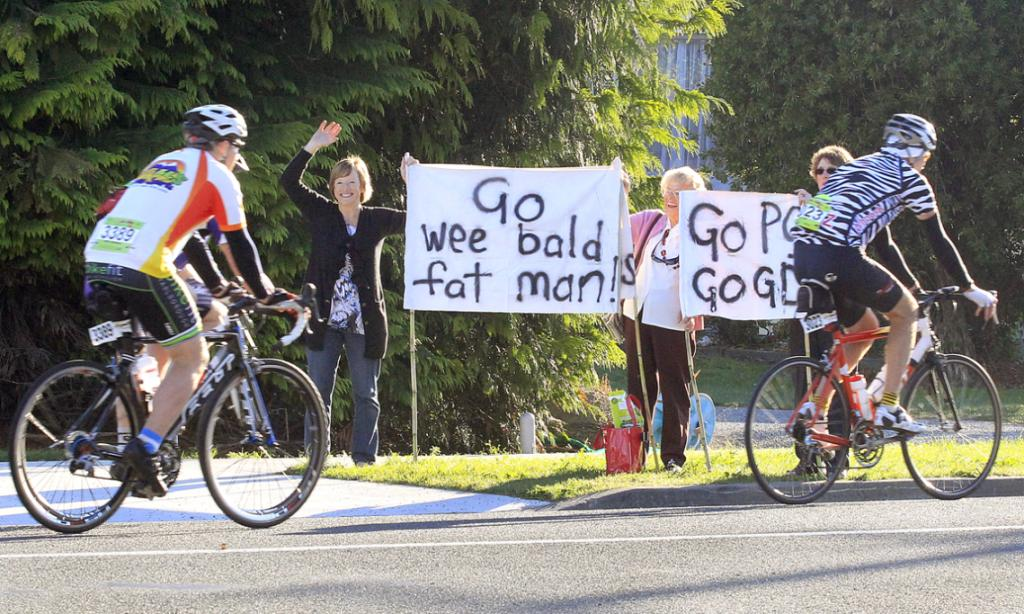 Supporters cheer on the riders