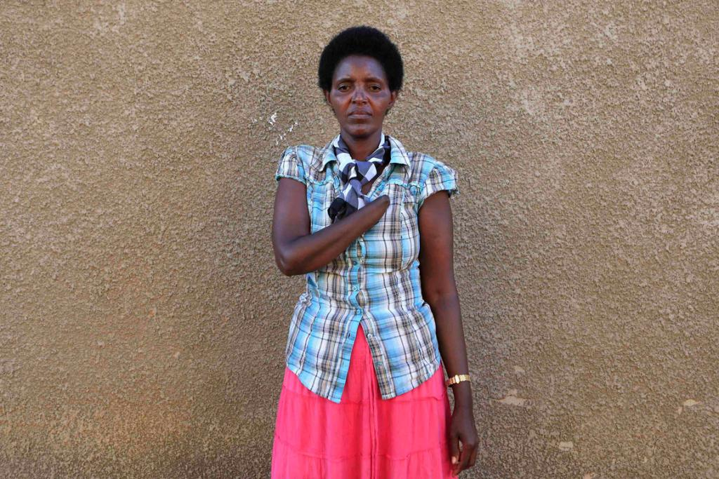 Alice Mukarurinda is now friends with the man who chopped off her hand and killed her baby daughter.
