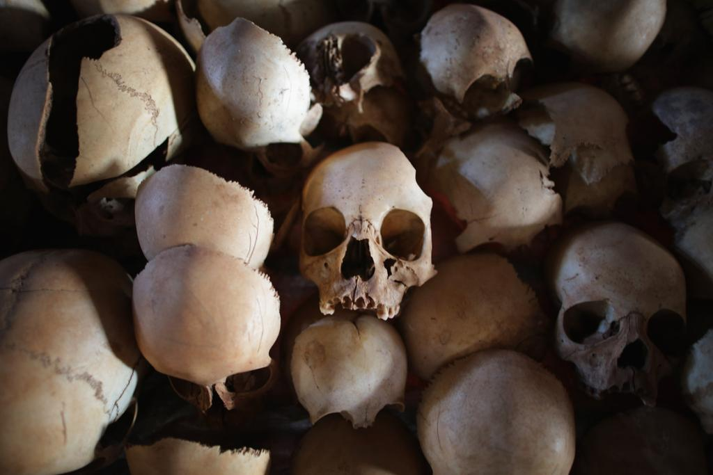 Showing signs of extreme trauma, victims' skulls are displayed on metal racks inside the Ntarama Catholic Church genocide memorial last week.