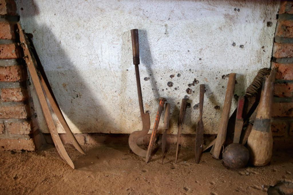 Instruments used to kill thousands, including crude farm tools, machetes, clubs, spikes spears and a canon ball, are displayed inside the Ntarama Catholic Church genocide memorial where more than 5,000 people were killed during the 1994 genocide in Nyamata, Rwanda.