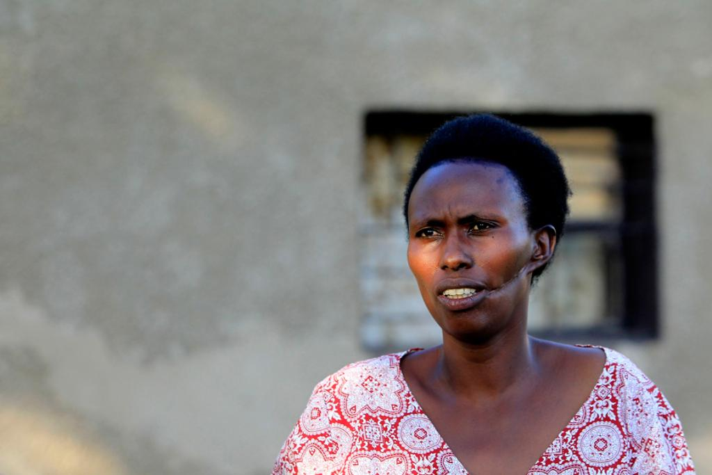 Alphonsine Mukamfizi, 42, survived three attempts on her life and had to fake death in order to survive. The rest of her 11 family members were killed.