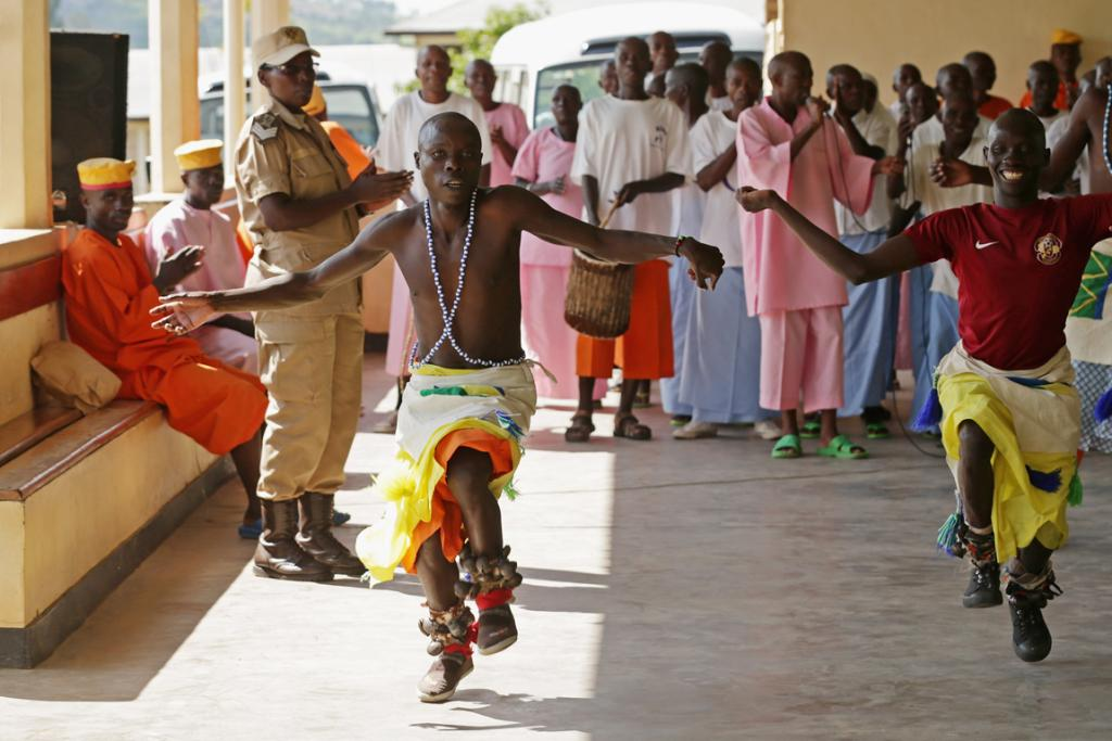 Prisoners sign and dance while welcoming a delegation from the US Holocaust Memorial Museum at the Nyanza Prison last week. Of the 6567 prisoners kept at the correctional facility, 5827 of them were convicted of participating in or leading the 1994 Rwandan genocide.