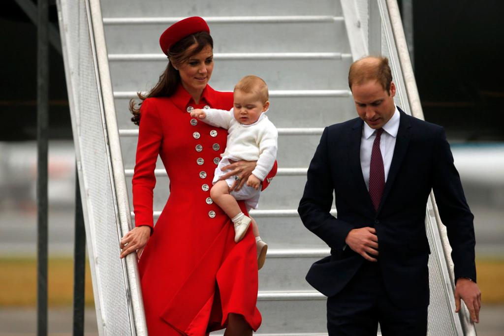 Prince George has his eyes on the steps as his parents prepare their game faces.