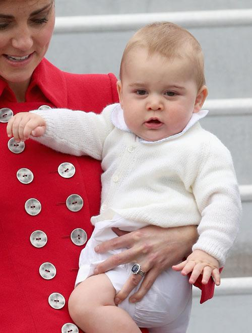 Prince George cuts a jaunty figure with his upturned collars and perfectly formed cheeks.