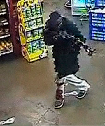 DISTURBING FOOTAGE: A gunman aims his rifle inside a store during an attack on the Westgate shopping mall in Kenya in October last year.