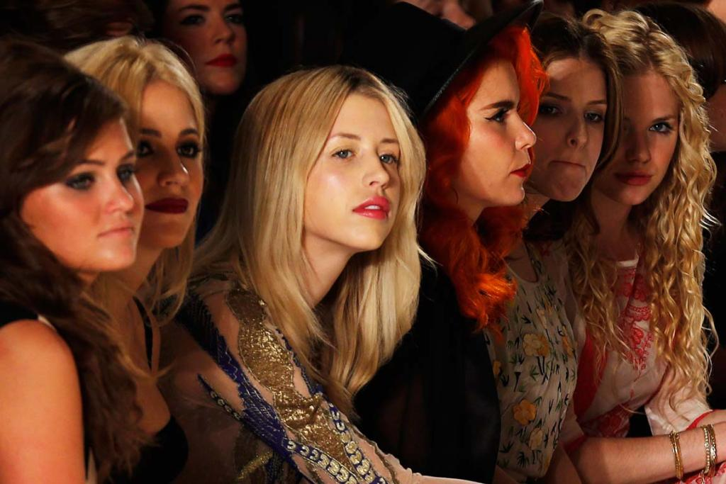 Peaches takes in a show at London Fashion Week in 2014.