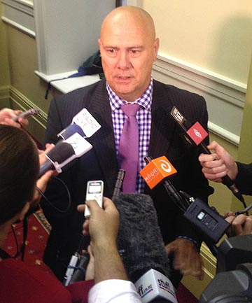 RETIRING: Tau Henare talks to reporters after tweeting he was leaving politics at the election.