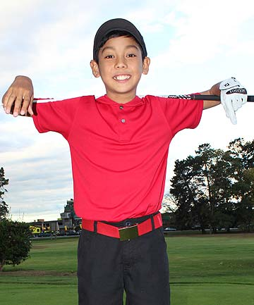 YOUNG TIGER: JB Misa emulates his hero Tiger Woods on the golf course.