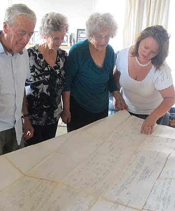 WHO'S THAT: The newfound family members study the family tree which dates back to the 17th century.