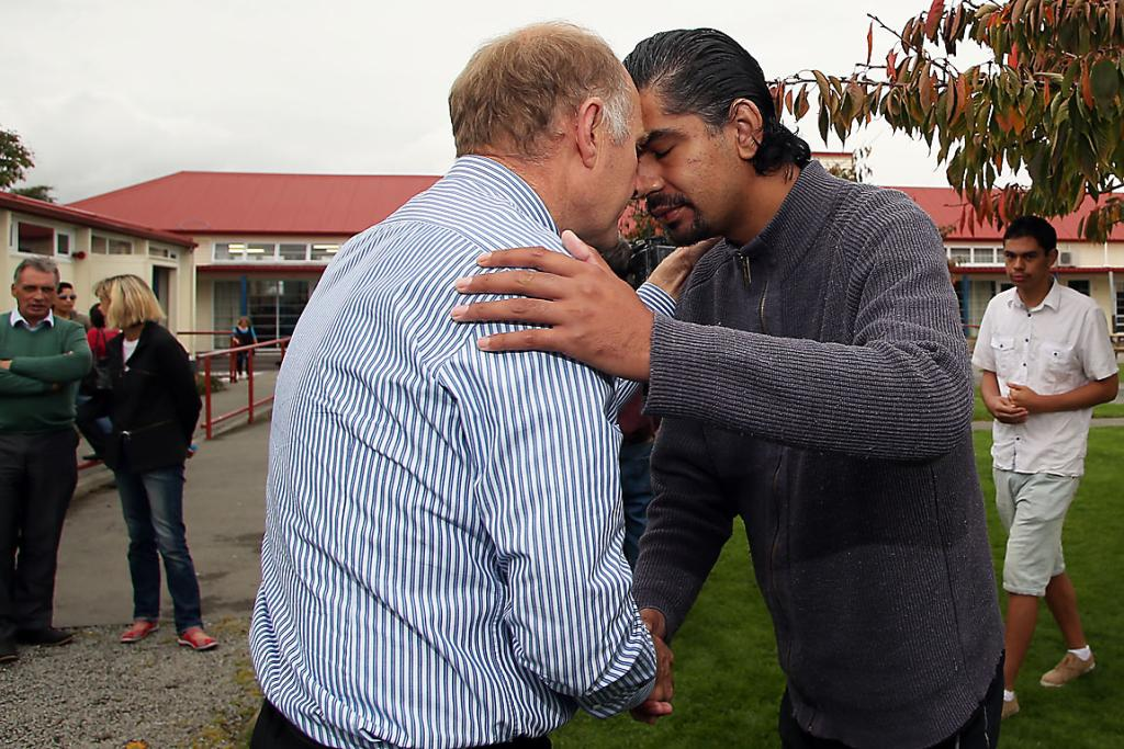SAD DAY: Phillipstown principal Tony Simpson shares a hongi with Maaka Tau following the announcement that the Ministry of Education will proceed with the closure of Phillipstown School.