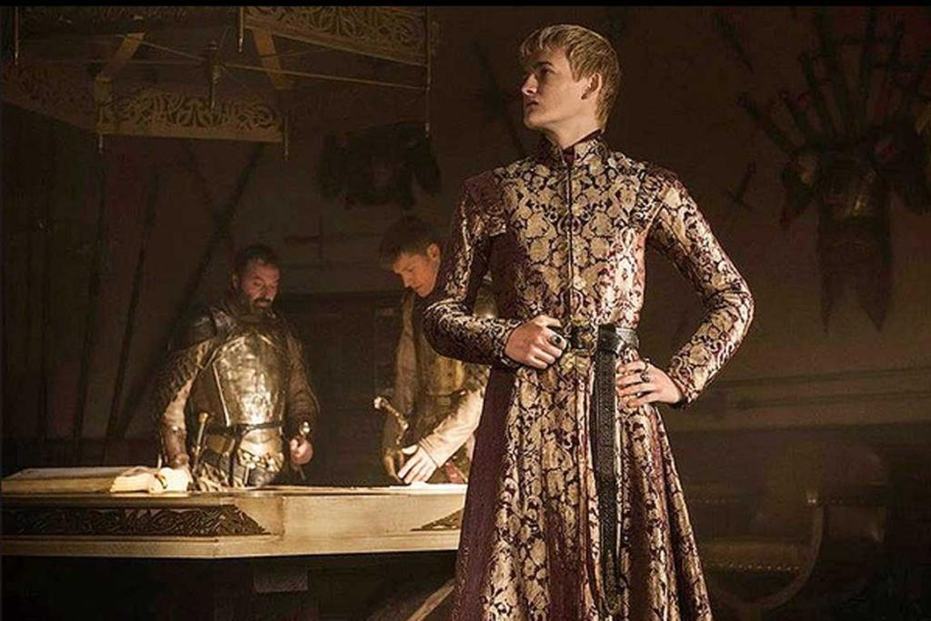 Game of Thrones season 4: King Joffrey Baratheon (foreground) with his father/uncle Jamie Lannister and another knight.