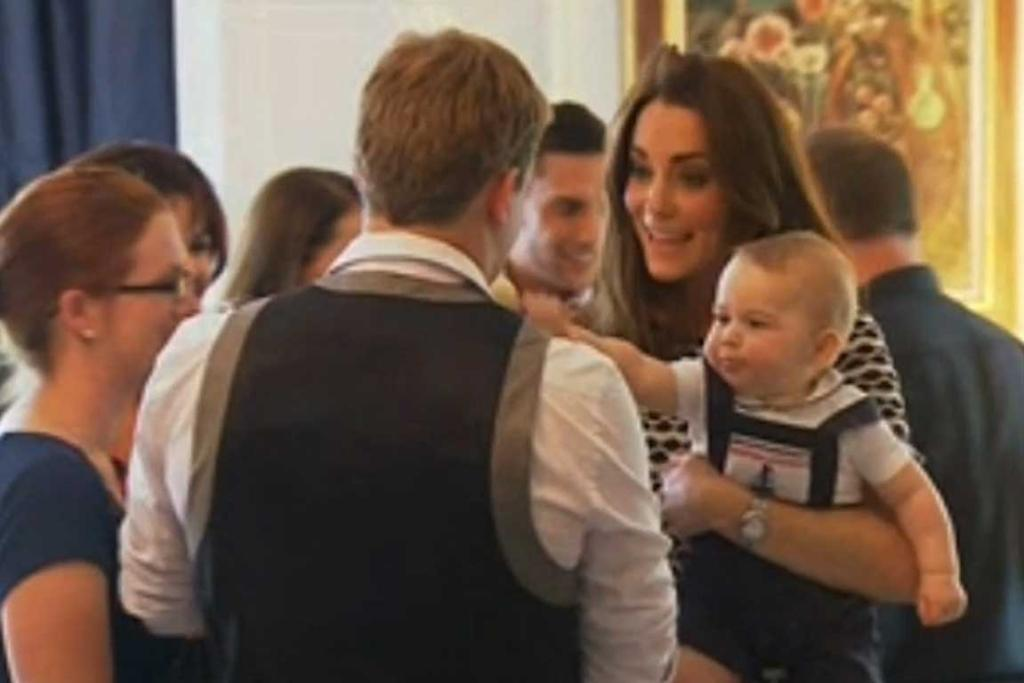 IT'S MINE! Prince George rocking a fine pair of overalls joins in the meeting and greeting with his mum, the Duchess of Cambridge.