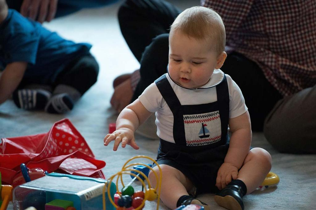 Prince George plays with toys.