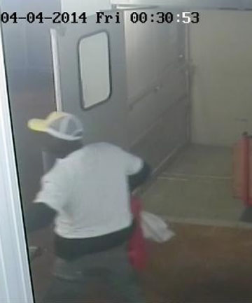 MAN SOUGHT: Police have released CCTV images of this man, seen entering a Kilbirnie self storage unit shortly before it went up in flames.