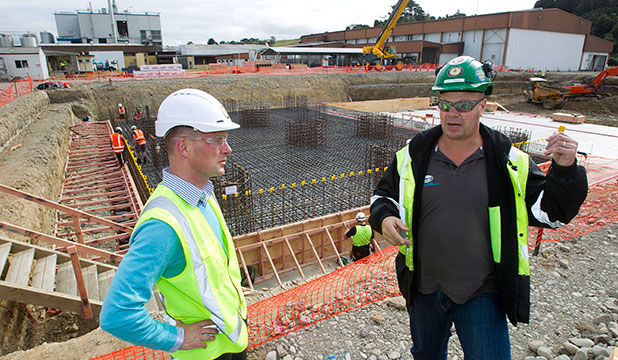 WORK BEGINS: Pahiatua Fonterra plant manager Bill Boakes and supervisor Scott Rowden stand in front of the building site.