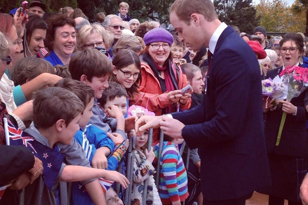 William puts on a friendship bracelet given to him by a child.