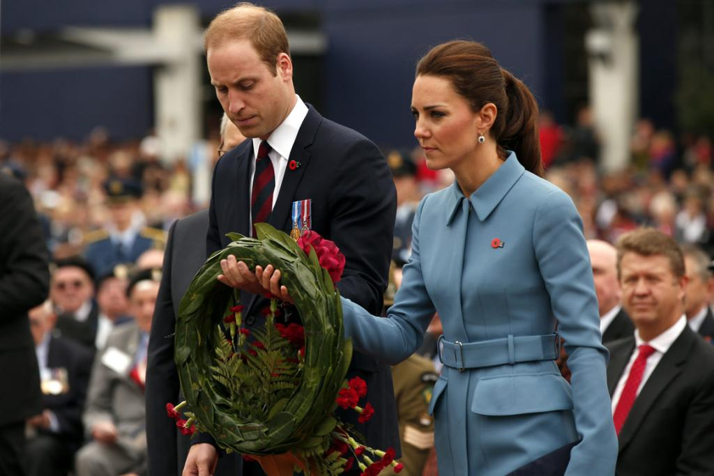 Prince William, Duke of Cambridge and Catherine, Duchess of Cambridge attend a ceremony at the war memorial in Seymour Square.