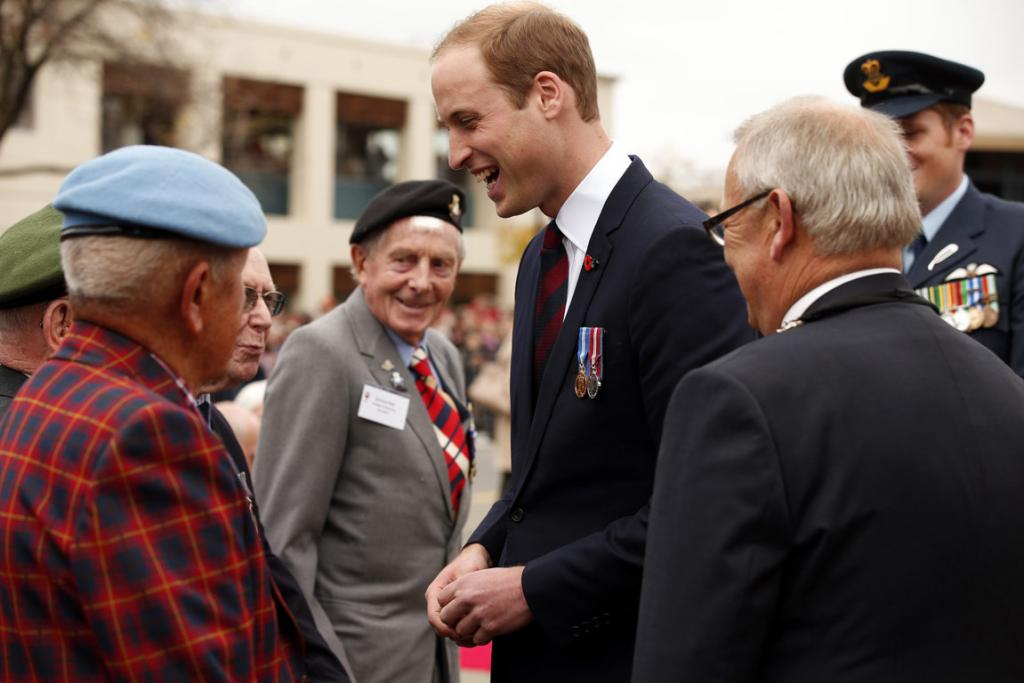 Prince William, Duke of Cambridge speaks with veterans after the ceremony.
