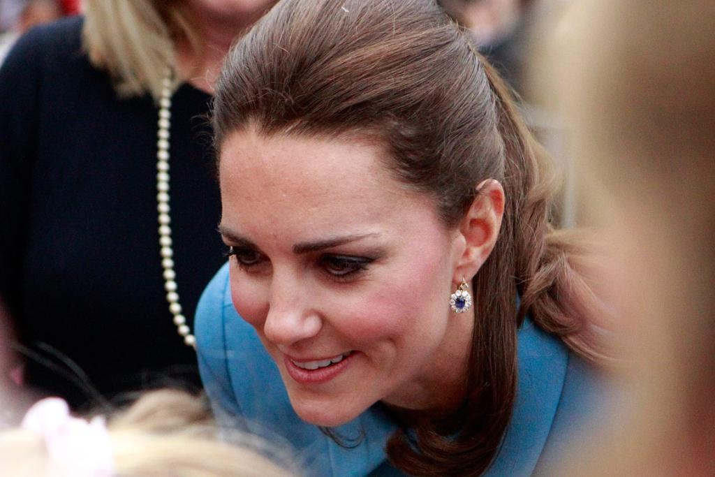 The Duchess of Cambridge talks to people during the public walk in Seymour Square.