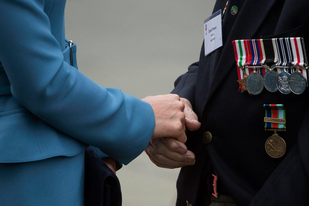 Kate holds hands with World War II veteran David Mason.