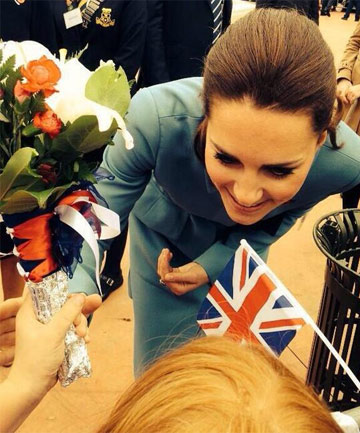 WORTH THE WAIT: Six-year-old McKenzie Jessop hands  the Duchess of Cambridge a bouquet in  Seymour Square in Blenheim.