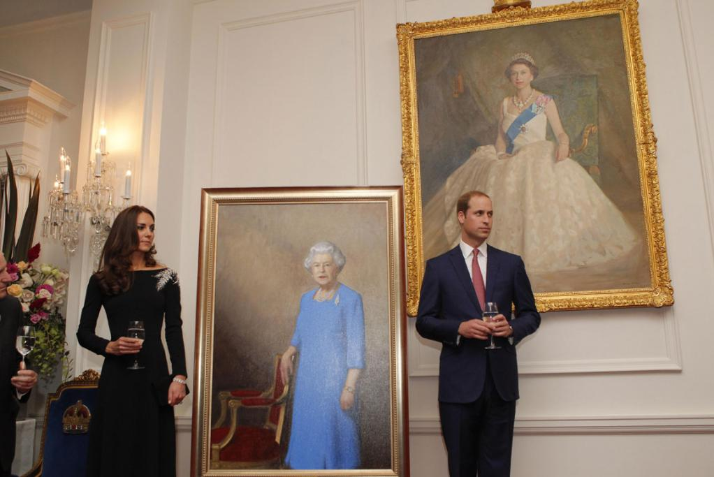 ROYAL MOMENT: The Duke and Duchess with the newest painting of the Queen.