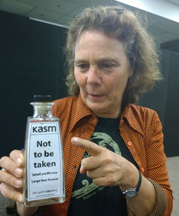 NO WAY: Vera van der Voorden clutches a bottle of black sand marked ''not to be taken'' at the Environment Protection Authority hearing in Hamilton.