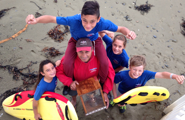 JUNIOR HIGH: Maranui Surf Life Saving Club captain Marc Pulepule with, from left, , 12. Then left to right: daughter Asha, 9, son Che, 12, on his shoulders, , 9, Marc Pulepule, Sophie Irving, 11, and Lukas Kelly-Heald, 8.