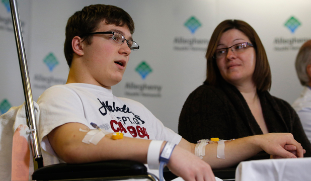 HAILED AS HERO: Brett Hurt sits with his mother Amanda Leonard at a hospital news conference.