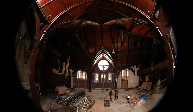 PRESERVING HISTORY: Stone-cladding contractor Richard Lloyd talks to Anna Crighton, chairwoman of the Christchurch Heritage Trust, inside the Trinity Church on the corner of Manchester and Worcester Sts in Christchurch.