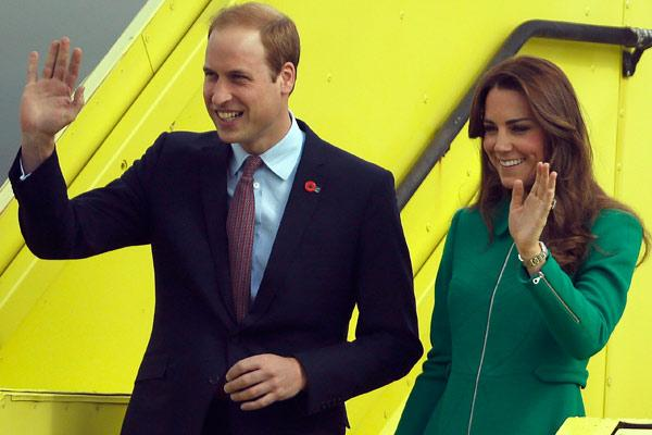 The royal couple wave as they walk down bright yellow steps onto the tarmac.