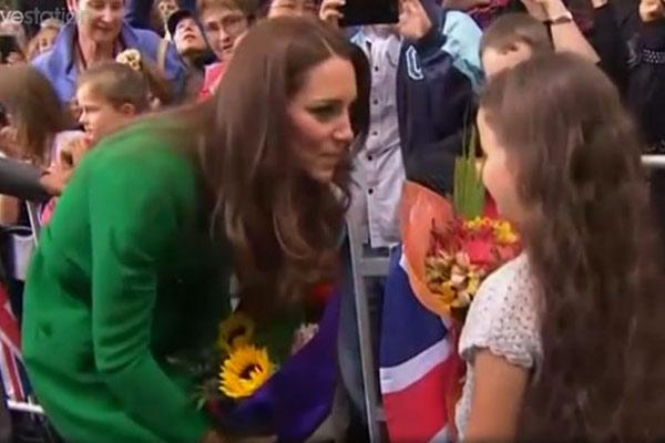 Kate speaks with a young girl in Cambridge.