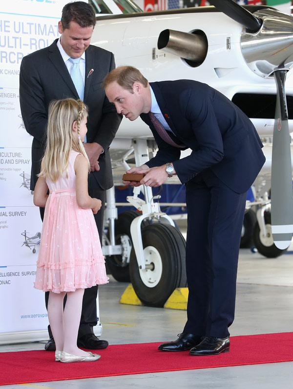 A young girl presents the Duke with a gift during this visit to Pacific Aerospace