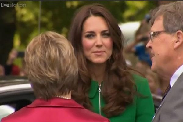 The Duchess speaks a pair in Cambridge before entering the town hall