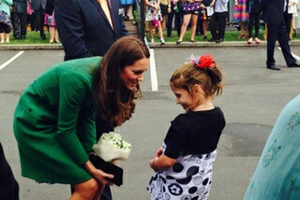 Six-year-old Kaiya Miller from Matamata speaks with Kate. Kaiya suffers from cystic fibrosis (CF) was chosen to present the duchess with a bunch of flowers during her visit.