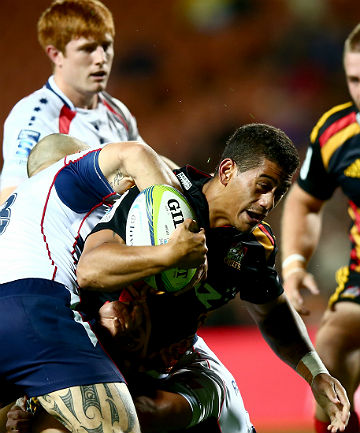 TOUGH WORK: Augustine Pulu of the Chiefs is tackled by Tamati Ellison.